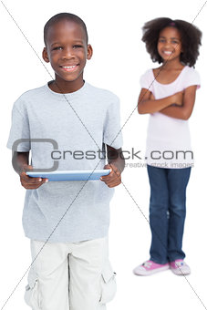 Boy using tablet pc with his sister