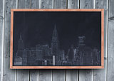 Drawing of a city on a blackboard