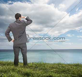 Stylish businessman looking at the sea