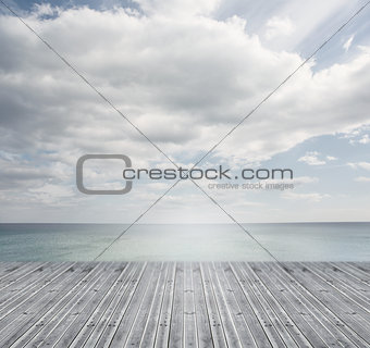 Wooden boards leading out to a bright horizon