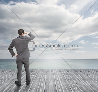 Well dressed businessman standing on wooden boards