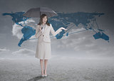 Businesswoman in front of blue map