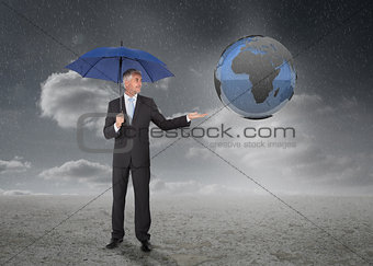 Businessman with blue umbrella