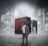 Businessman looking at red servers