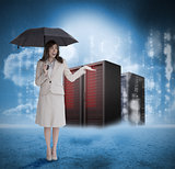 Businesswoman with umbrella in front of red servers