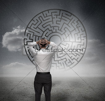 Anxious businessman looking at maze