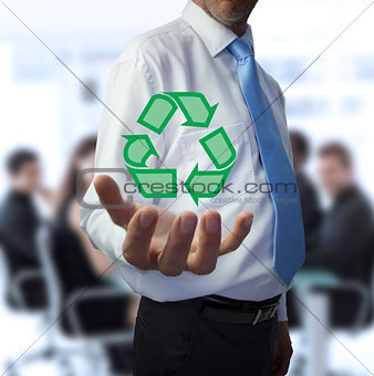 Businessman holding the recycling symbol