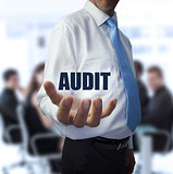 Smart businessman holding the word audit
