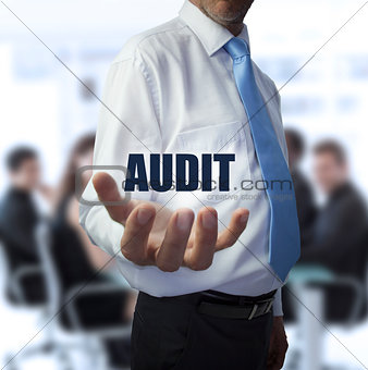 Smart businessman holding the word audit