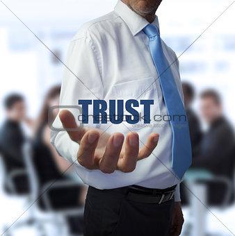 Smart businessman holding the word trust