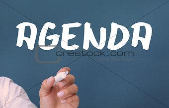Agenda written on blue background