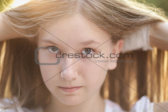 close up portrait of attractive teen girl in sunset