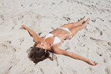 Sunbathing woman lying on beach