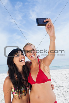 Friends taking picture and smiling