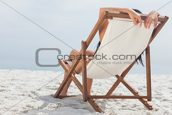 Woman lying on her deck chair