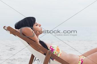 Beautiful woman sleeping on deck chair