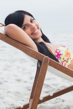 Beautiful woman resting on deck chair
