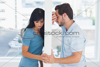 Divided couple are separated by white wall