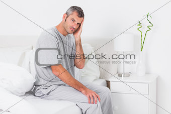 Anxious man holding his head