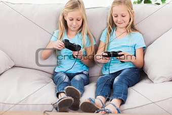 Cute twins playing video games together