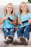 Young twins playing video games together