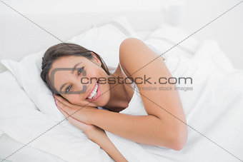 Beautiful woman resting in bed