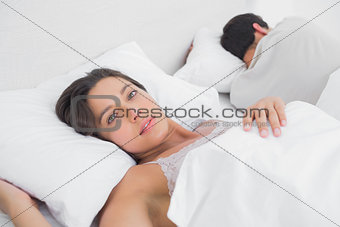 Thoughtful woman sleeping in bed