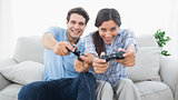 Couple playing video games on the couch