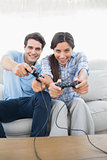 Portrait of a couple playing video games on the couch