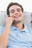 Man laughing while being on the phone