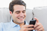 Man text messaging with his phone