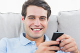 Portrait of a man text messaging with his phone