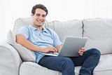 Portrait of a man using his laptop