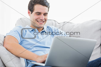 Attractive man using his laptop