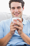 Portrait of a man holding a cup of coffee