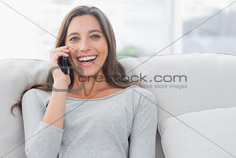 Portrait of a woman having a phone conversation