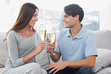 Lovers clinking their flutes of champagne