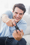 Portrait of a cheerful man playing video games