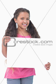 Little girl holding and presenting sign at camera