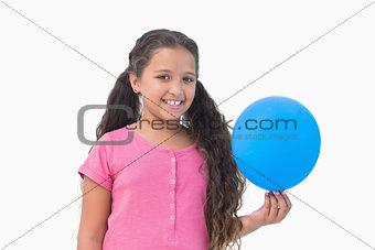 Little girl holding blue balloon