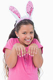 Little girl does an imitation of rabbit