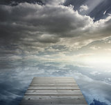 Wooden bridge leading to horizon