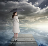 Businesswoman standing on bridge