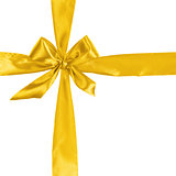 cross from yellow ribbon with bow