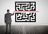 Businessman drawing a line through qr code
