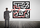Businessman drawing a red line through qr code