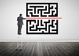 Businessman standing on a ladder drawing red line through qr code