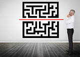 Thoughtful businessman looking at qr code