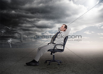 Attractive businessman sitting on a swivel chair