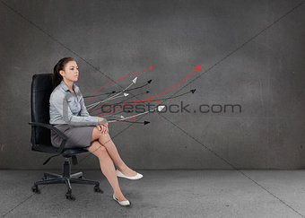 Attractive businesswoman relaxing on her chair